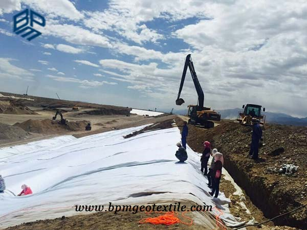 Woven textile for road construction